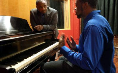 A successful businessman builds hope through music and scholarships